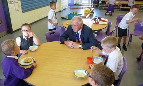 Derek Parkinson chatting with some of the breakfast club children.
