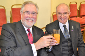 Phil Gardner (left) toasting his long-time friend Tony Woof Jackson.