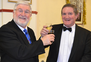John Robson (left) and Jim Hamilton toasting each other's health.