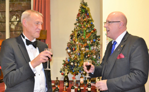 The lodge junior warden Ian Coates (left), with Gary Rogerson singing the master's song.