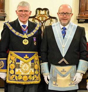 Congratulating Robert Wilson of Warrington Lodge of Concord.