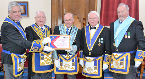 Pictured from left to right at the presentation of the MCF 2021 Festival Patron's certificate are: Simon Hanson (group charity rep), Harry Cox, Alan Long, Gordon Brown and Graham Earl (lodge charity steward).