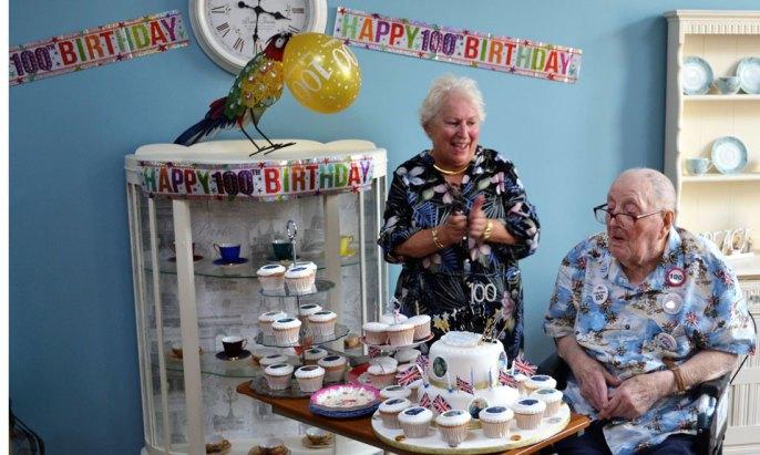 Rita Cheminais (left) and Derek Brear with the birthday cake.