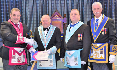 Presentation of the 'Grand Patronage' certificate. Pictured from left to right, are Scott Devine, Ron Rich, Daniel Crossley and John Karran.