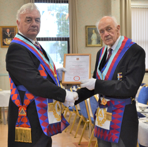 Barrie Crossley (left) with Tom Holroyd proudly holding his commemorative certificate.