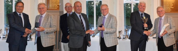 Pictured from left to right, are: Tom Walsh collecting the 'Nearest the Pin' Prize on behalf of Alan Ray from Derek Parkinson; Jim Eddowes collecting his 'runner-up' award from Derek Parkinson, with Phil Pattullo in the background and a delighted Ronnie Mills receives the 2029 Trophy for the winning visitor from Derek Parkinson