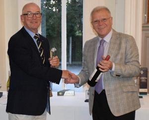 Winner of the Liverpool Group Trophy Thomas Philip Pattullo (left) receiving his trophy from Derek Parkinson.