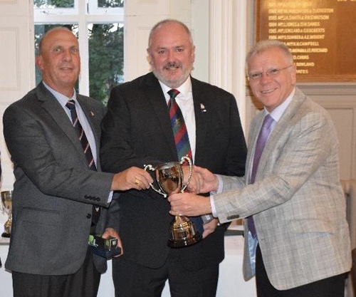 Pictured from left to right, are Jim Eddowes and Bob Paterson, both of Everton Lodge, receiving the Presidents Cup from Derek Parkinson.
