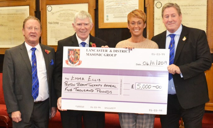Emma Ellis receiving the award from left to right: Paul Broadly, Provincial Grand Master Tony Harrison and Neil McGill.