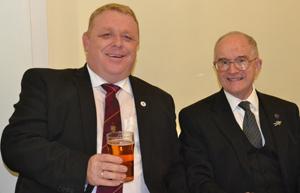 Tony Jackson (right) congratulating his successor as first principal Dan Crossley.