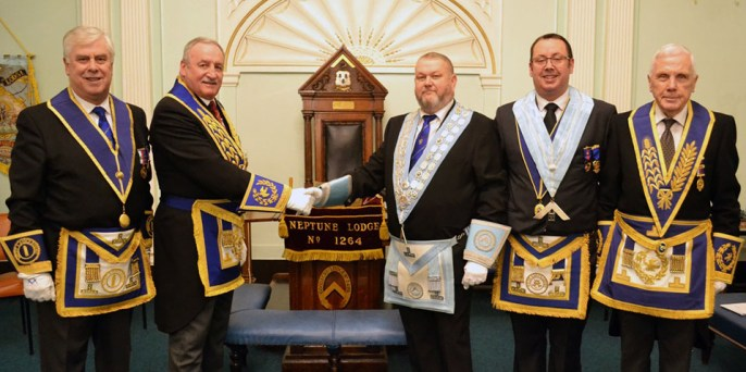 Pictured from left to right, are: Dave Johnson, Sam Robinson congratulating WM Rob Morris, Dave Campbell and Bob Hall.