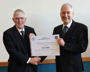 Tony (left) receives a cheque from Stephen Blank for the MCF Festival.