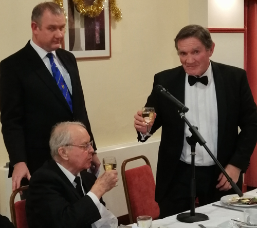 A toast to John's health. Pictured from left to right, are: Ian Halsall (rear), John Potts and Jim Hamilton.