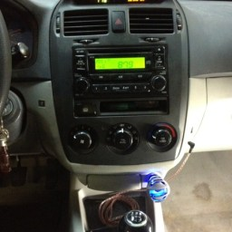 Auxiliary Input With Charging Capability Added to Kia Spectra