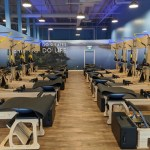 Club Pilates interior view of the equipment & wall graphics
