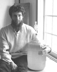 Charles Eisenstein with soda container