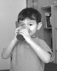 Child drinking homemade soda
