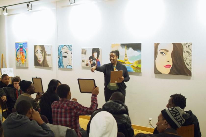 Ify Chiwetelu- Program Coordinator managing the Poetry Slam.