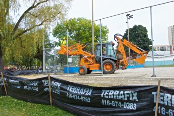 Fencing being removed in preparation for court resurfacing.