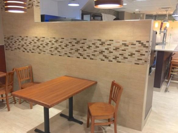 Butcher block tables and ceramic decor.