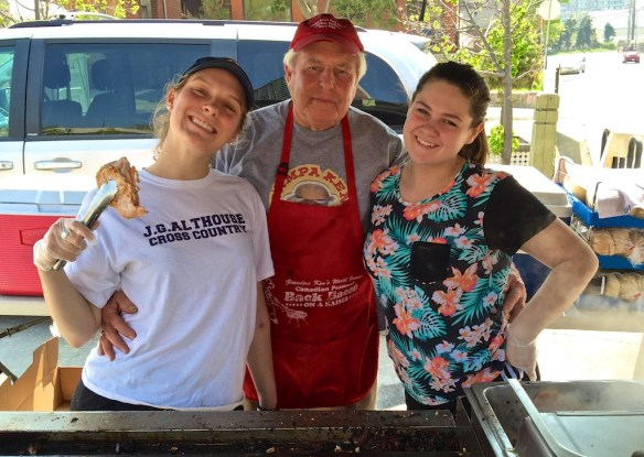 Grandpa Ken has sold delicious peameal bacon sandwiches at the Farmers Market for 31 years. He's a grandpa many times over. Helping out is a granddaughter and her friend.