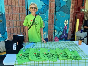 Debbie Gibson from the B.I.A. sells Farmers Market fundraising T-shirts
