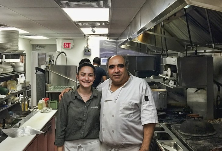 Frank Kalamaris and his daughter Katrina cook for their customers at their restaurant P&Ms on Weston Road.