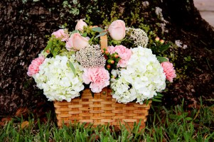 Old Fashioned Country Basket - White hydrangeas, pink roses and carnations accented with hypericum berries and lush garden foliage $75.00
