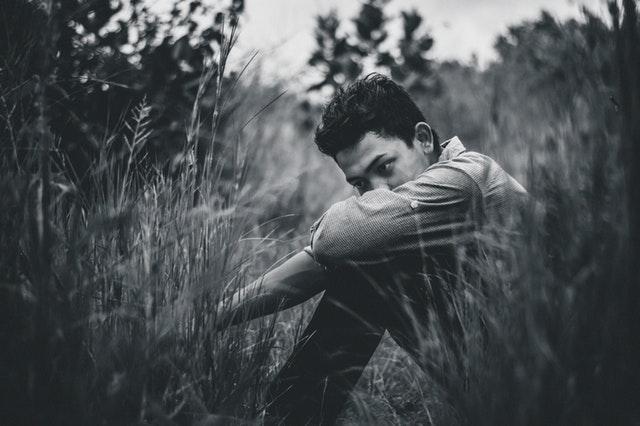 sad teen sitting outdoors