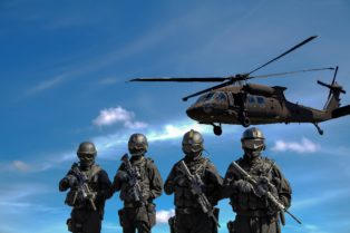 stock image of four people holding assault rifles with a helicopter hovering behind them