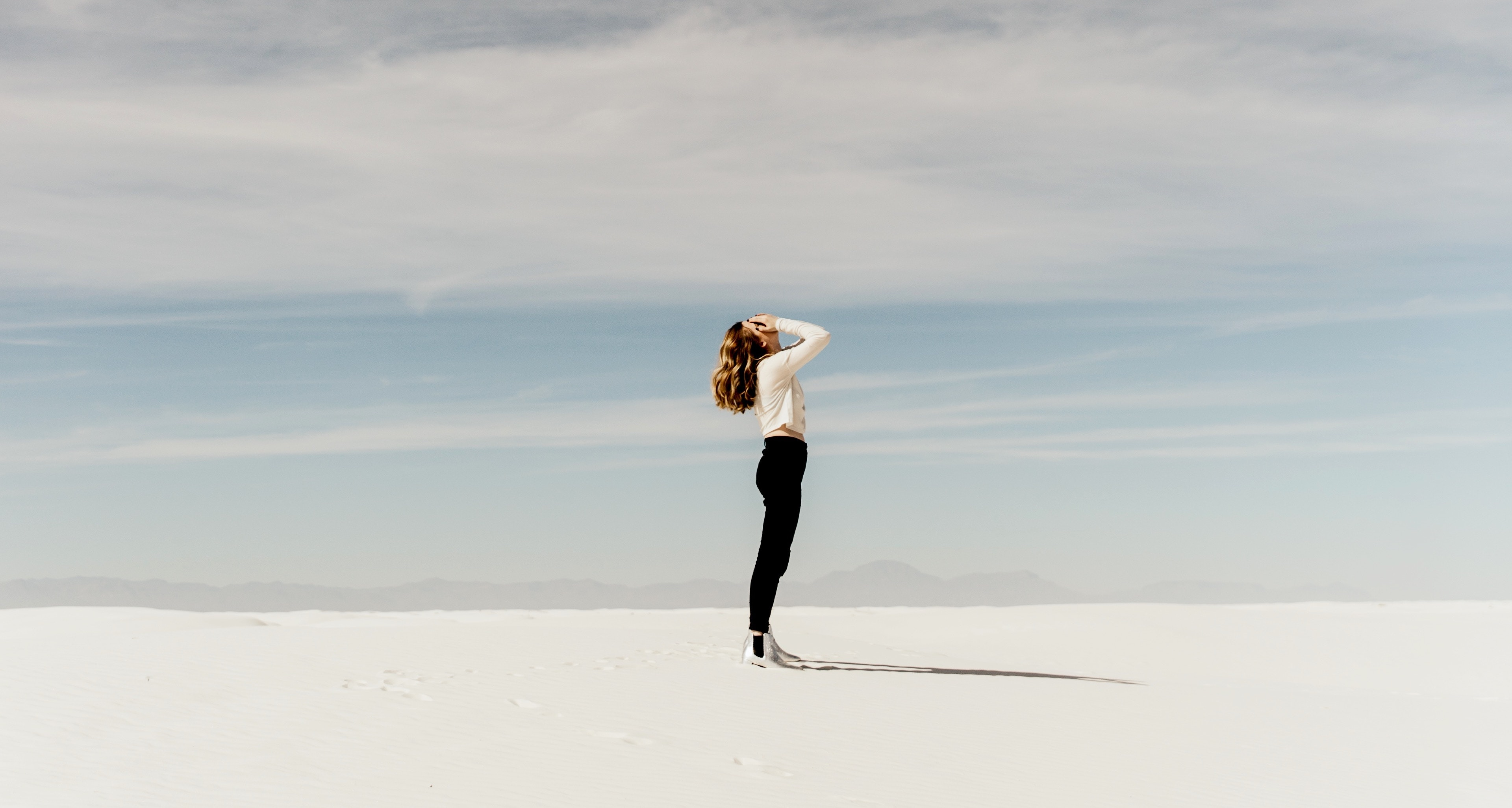 Stock photo of woman standing in a desert