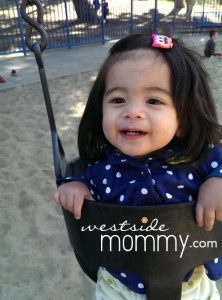 Aria enjoying the bucket swing at Cheviot Hills Park playground