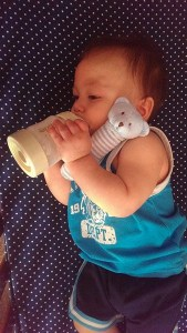 photo provided by Stacey V. Teddy enjoying his Mixie bottle and Angel Dear rattle from SpringFest Swag Bag giveaway 01