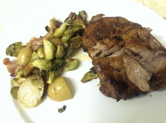 Pork Ribs with BBQ sauce and a side of roasted potato, Brussels sprout, and bacon