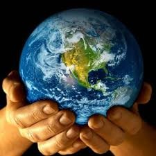 The Organic System - Hands holding globe