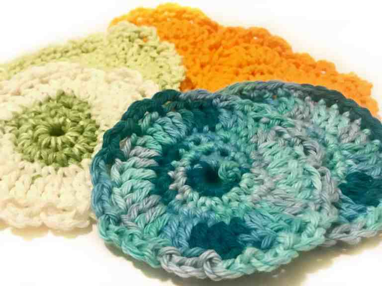 Reusable Face Scrubbies are the perfect cotton ball replacer. These eco friendly face pads effectively remove makeup and are great for applying astringent. Save money by washing them again and again. Facial Scrubbies are easy to make so grab your FREE crochet pattern and have them finished in under 30 minutes. | We Three Shanes
