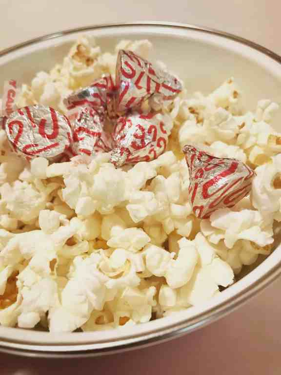 3 ingredients is all you need to make The Easiest White Chocolate Peppermint Popcorn. This heavenly holiday treat comes together in seconds with no crushed candy canes in sight! It's a lazy gals dream. | We Three Shanes