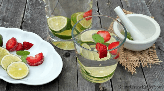 Strawberry Lime Mint Flavored Water is a refreshing way to stay hydrated this Summer. Check out this recipe and 16 other Flavored Water Recipes by clicking the link! | We Three Shanes