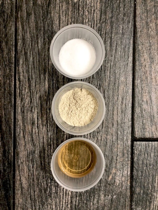 Epsom Salt, Bentonite Clay, and Apple Cider Vinegar are used to make this DIY Detox Clay Foot Mask & soak. Draw out toxins, relieve stress. and soften feet. | We Three Shanes