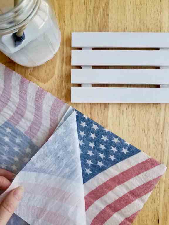 Learn all the steps and tips you need to decoupage with napkins by following this patriotic American flag mini pallet using Dollar Store supplies. | We Three Shanes
