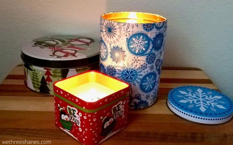 Learn how to make Christmas Tin Candles using supplies from the Dollar Tree. They make a great addition to holiday decor or give them away for a fun DIY gift. | We Three Shanes