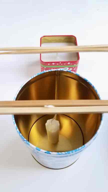 Learn how to make Christmas Tin Candles using supplies from the Dollar Tree. They make a great addition to holiday decor or give them away for a fun DIY gift.   We Three Shanes