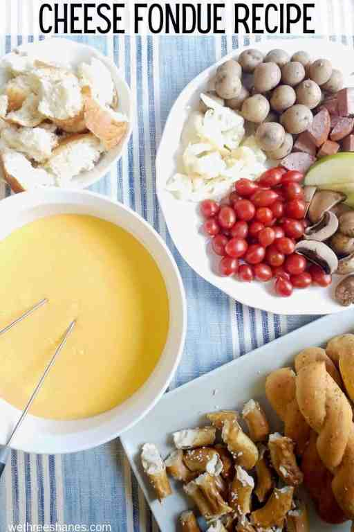 Make this family friendly Cheddar Cheese Fondue Recipe as a fun party snack, date night at home, or family dinner for a special occasion. | We Three Shanes