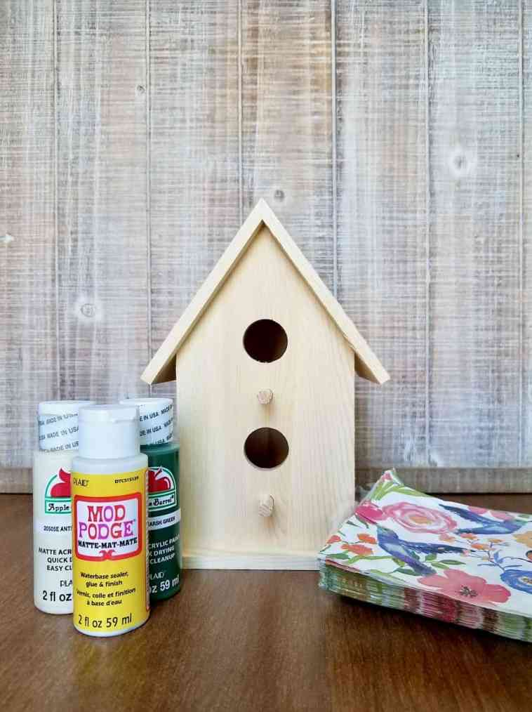 Learn how to decoupage a birdhouse using napkins to create a budget-friendly, shabby chic decor piece for your home or front porch. | We Three Shanes