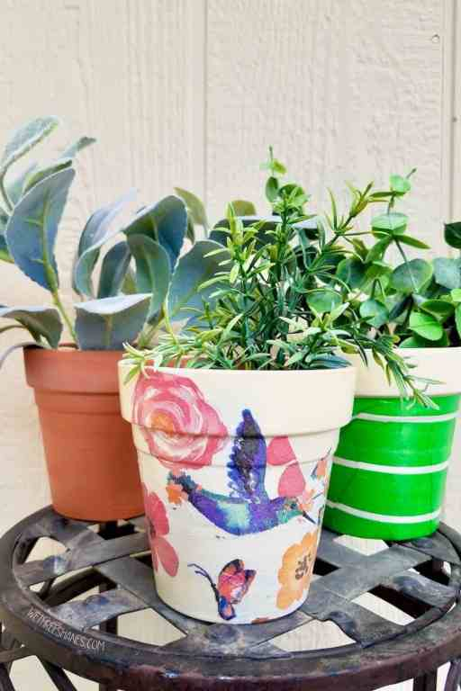Learn how to decoupage terracotta pots with napkins for some original spring and summer decor. | We Three Shanes