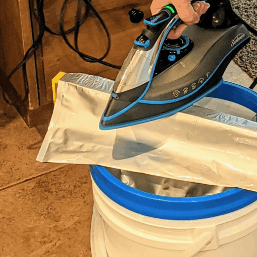 Using a hot iron to seal a mylar bag.
