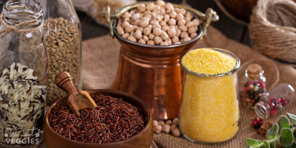 Variety of pantry grains & beans on a wooden table