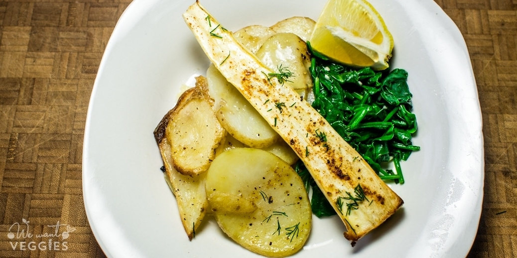 Parsnip filets with potato slices and wilted spinach
