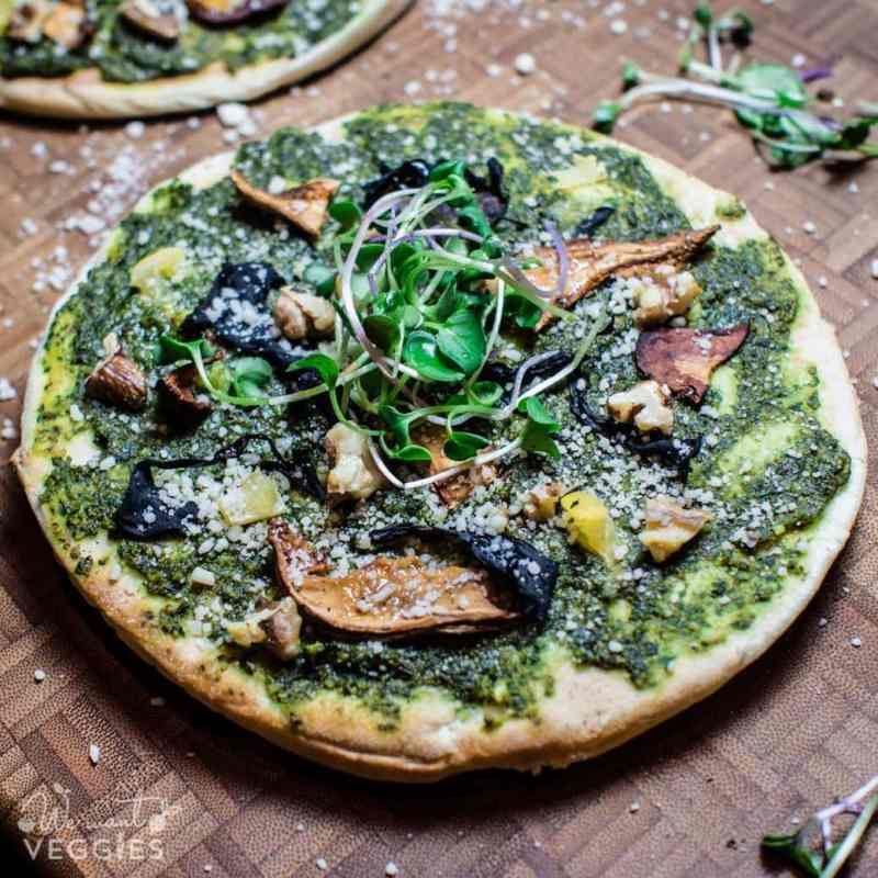 A delicious Forager Pita Pizza on a cutting board