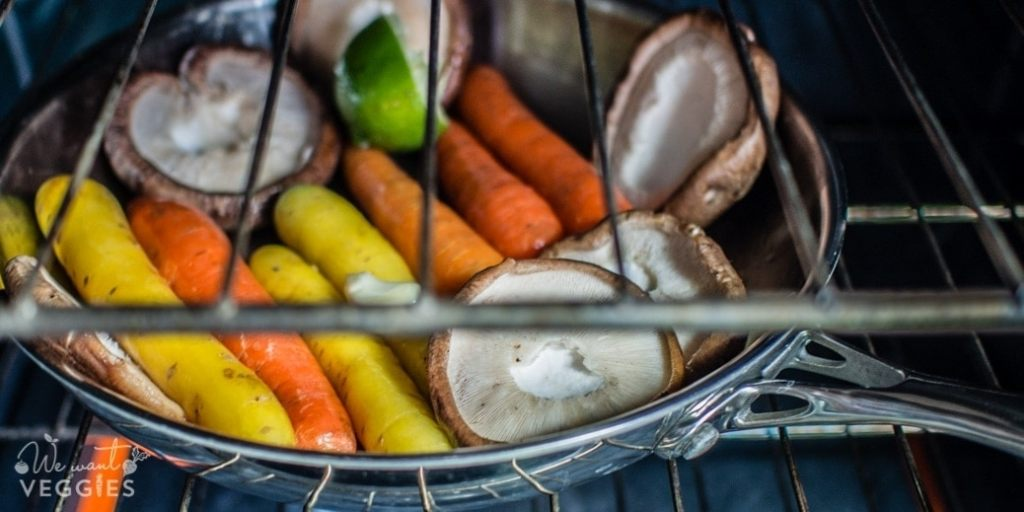 Saute pan with carrots & mushrooms in the oven.